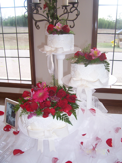 Wedding Cake with live flowers.